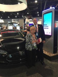Gail Chiasson examines the Volta electric charging station with Brian McClimans